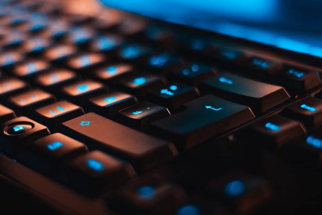 A black keyboard with blue light