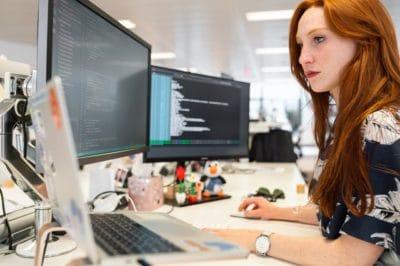 A woman staring at a monitor