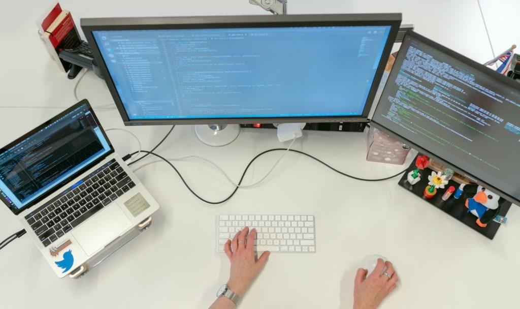 A man writing at a computer