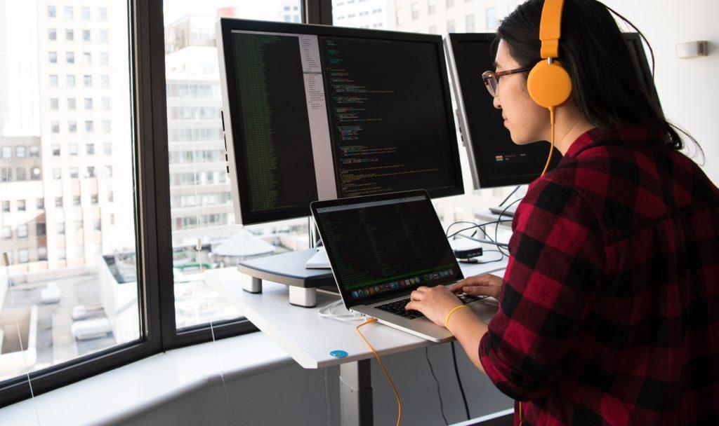 A woman at her computer monitors
