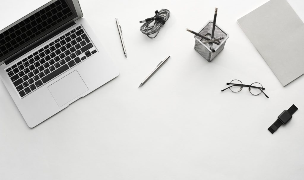 A collection of desk items including laptop