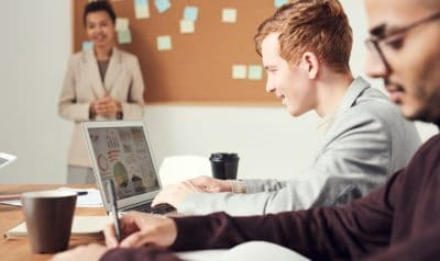 A man smiling at a computer