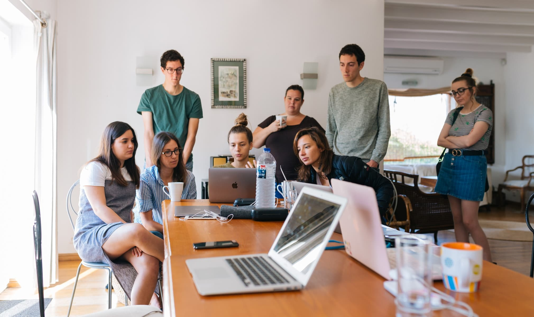 A group of coders at a table